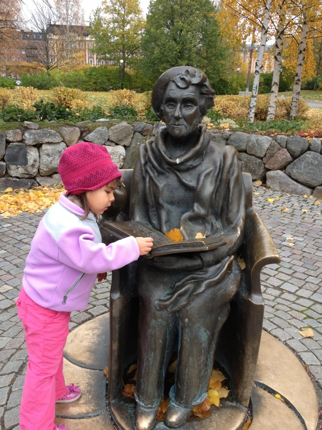Maggie next to statue of Astrid Lindgren
